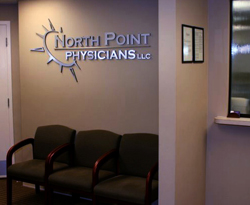 Doctors office sign with 3D letters and logo of metal laminate mounted on acrylic