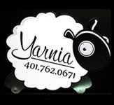A sheep shaped custom sign for a yarn shop