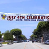Example of advertising for a Fourth of July celebration on a versatile Street Banner