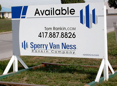 picture of a large real estate yard sign