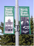 Street pole mount vinyl banner.