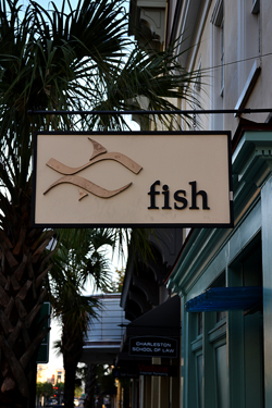 3D logo and name on a hanging sign for a seafood restaurant