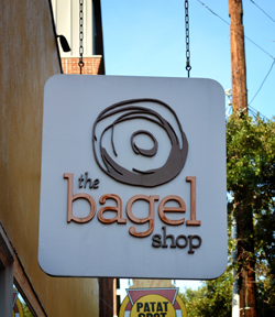 3D bagel and business name on a bagel shop sign