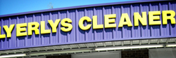 Letters mounted above a dry cleaner's storefront
