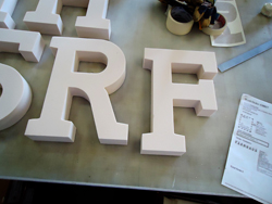 3D letter made of foam being made