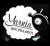 A sheep shaped custom sign for a yarn shop