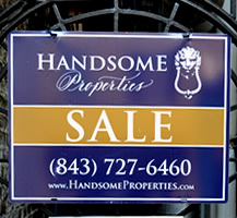A fence-mounted sign for a realtor made of dibond