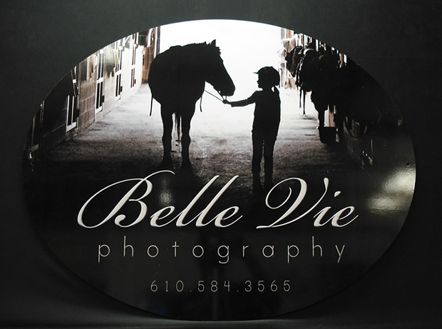A photo of a custom dibond sign for a photograpy studio