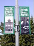 Street pole mount vinyl banner.